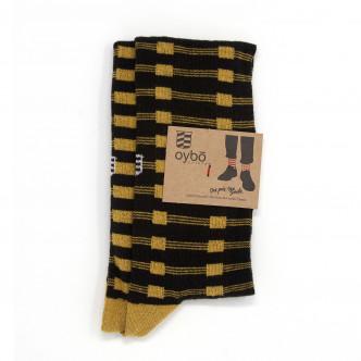 Chaussettes dépareillées jaunes et noir par Oybo