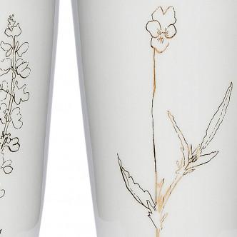 Motif fleur doré sur porcelaine blanc brillant